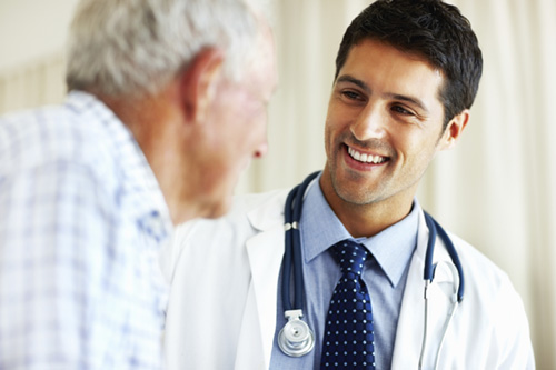 caring-doctor-with-ill-patient