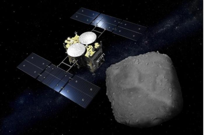 رسم بالكمبيوتر للمسبار الياباني هايابوسا 2 لدى وصوله إلى كويكب في صورة من وكالة الفضاء اليابانية