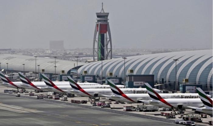 طائرات لطيران الإمارات تقف في مطار دبي الدولي، الإمارات