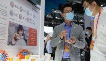 جناح سينوفاك للترويج لـ لقاح فيروس كورونا في معرض بكين التجاري - الصين